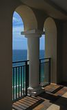 Ocean Through Twin Arches. A beautiful view of the ocean and waves through an arches of a balcony Royalty Free Stock Photography