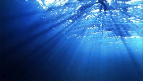 Ocean underwater. With rays of light