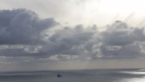 Silver Clouds and cloudscape over water. Ocean Vessel traveling out to the Horizon stock video