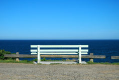 Ocean view. White wooden bench, ocean view, solitude Royalty Free Stock Image