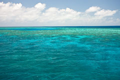 Ocean View. Ocean blue water with reef in the distance Royalty Free Stock Photos