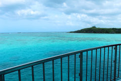 Ocean View. A picture of a beautiful teal ocean and a small island stock images