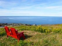 Ocean View. Red chair on rocky coastline. Atlantic Ocean view: Nova Scotia, Canada Royalty Free Stock Photo