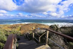 Ocean view against blue sky as seen from Cape Leeuwin lighthouse attraction at western australia.  royalty free stock image