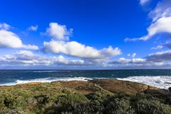 Ocean view against blue sky as seen from Cape Leeuwin lighthouse attraction at western australia.  royalty free stock photos