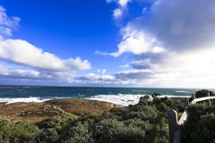 Ocean view against blue sky as seen from Cape Leeuwin lighthouse attraction at western australia.  stock images