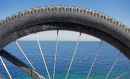 Ocean view through bike rim royalty free stock images