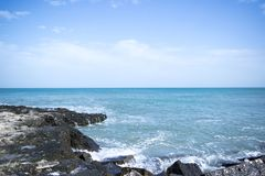 Ocean View With Black Rock Formation Stock Photo