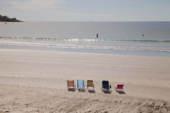 Ocean view. Chairs on the beach and swimmers in the ocean of York beach, USA Stock Photography