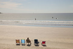 Ocean view. Chairs on the beach and swimmers in the ocean of York beach, USA Royalty Free Stock Photo