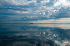 Ocean view and clouds reflection in the water in Gili Air Island Royalty Free Stock Photo