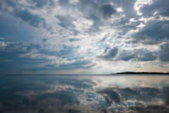 Ocean view and clouds reflection in the water in Gili Air Island Royalty Free Stock Photos