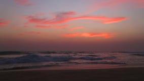 Ocean view in Hikkaduwa in sunset with waves splashing the beach. stock video