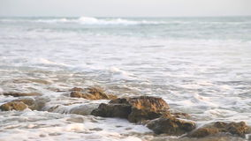 Ocean view in Hikkaduwa in sunset with waves splashing the beach. stock video footage