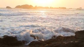 Ocean view in Hikkaduwa in sunset with waves splashing the beach. stock footage