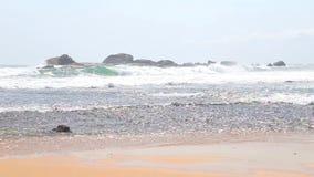 Ocean view in Hikkaduwa with waves splashing the beach. stock footage
