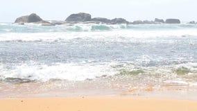 Ocean view in Hikkaduwa with waves splashing the beach. stock video