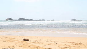 Ocean view in Hikkaduwa with waves splashing the beach. Hikkaduwa is famous for its beautiful sand beaches. stock footage