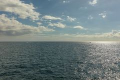 Ocean view with horizon. And clouds in the sky Royalty Free Stock Photo