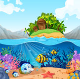 Ocean view with island and fish underwater. Illustration Royalty Free Stock Image