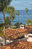 Ocean View, La Jolla California. Red tiled roofs and palm trees provide a foreground for a view out to the calm blue waters of the Pacific Ocean in La Jolla, San royalty free stock photography