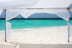 Ocean view, Maldives. The ocean view through a white tent on a coast Royalty Free Stock Images