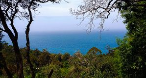 Ocean view from mountain peak stock photography