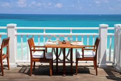 Ocean view restaurant. A table at a terrace of a romantic ocean view restaurant at the luxurious resort on the Paradise Island, the Bahamas royalty free stock photo
