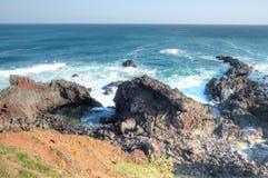 Ocean view at Seopjikoji, Jeju Island. Craggy cliffs and ocean view at Seopjikoji, Jeju Island, South Korea Stock Photos