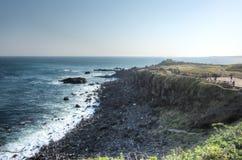 Ocean view at Seopjikoji, Jeju Island. Craggy cliffs and ocean view at Seopjikoji, Jeju Island, South Korea Royalty Free Stock Images