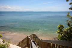Ocean view. Steps leading down to a beach stock images