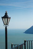 Ocean view with street lantern and railings Royalty Free Stock Photo