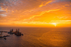 Ocean view on the sunrise. Beautiful ocean view with cloudy sky and cargo vessel on the sunrise Stock Photography