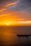 Ocean view on the sunrise. Beautiful ocean view with cloudy sky and cargo vessel on the sunrise Royalty Free Stock Images