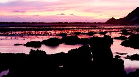 Ocean view at sunset. Landscape of an ocean at sunset in Bettys Bay, South Africa stock photo