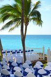 Decorated chairs lined up for a civic wedding ceremony at a resort hotel. Ocean view tropical island matrimony celebration set up. Holiday resort. White wedding royalty free stock image