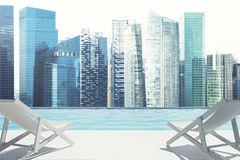 Ocean view with two deck chairs, city. Two deck chairs are standing on an ocean shore. A magnificent cityscape in the background. 3d rendering mock up Royalty Free Stock Image