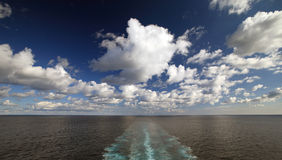 Panoramic ocean view with wake trace from cruise ship Royalty Free Stock Photography