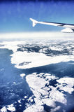 Ocean view from the airplane. Ocean view through the window of the airplane in winter Stock Photography