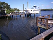 Ocean View of Wood Pier, Dock and Boat. Daytime Ocean View of Wood Pier, Dock and Boat Royalty Free Stock Photography