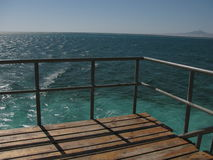 Ocean. View from wooden pier into the red sea Stock Image