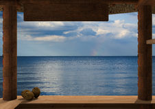 Ocean viewed from a kiosk. Rendering of the view from a kiosk on the beach. From the kiosk is visible the ocean. On the plane of the kiosk, on the left there are royalty free illustration