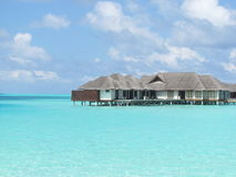 Ocean villa. Houses on the water in the sea and sunny sky background Royalty Free Stock Photography
