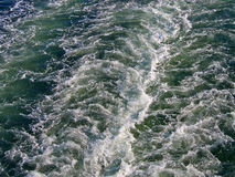 Ocean wake behind a big ferry ship boat Royalty Free Stock Photo