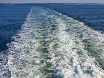Ocean wake behind a big ferry ship boat Stock Image