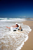 Ocean washout. Woman in beach chair being washed out by ocean Royalty Free Stock Photography
