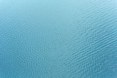 Ocean water from above. Sea surface background with ripple and reflection of sunlight from above Royalty Free Stock Photos