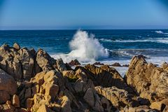 Ocean Water Explosions. Pacific Grove, California - USA; February 20, 2018; Located between Monterey and Pebble Beach, visitors and residents to Pacific Grove Royalty Free Stock Photography