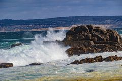 Ocean Water Explosions. Pacific Grove, California - USA; February 20, 2018; Located between Monterey and Pebble Beach, visitors and residents to Pacific Grove Royalty Free Stock Image