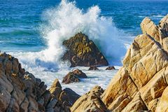 Ocean Water Explosions. Pacific Grove, California - USA; February 20, 2018; Located between Monterey and Pebble Beach, visitors and residents to Pacific Grove Stock Photos